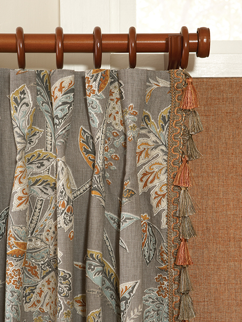 Blinds and Designs' Fabric Window Coverings hanging from a Drapery rod.
