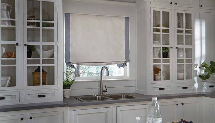 A kitchen with roman shades, we provide roman and roller shades in Nashville, TN, Brentwood, TN and Franklin, TN.